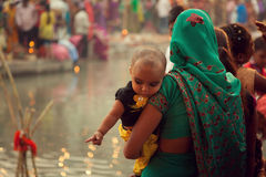 Indian women and children at river side Stock Image