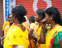 Indian women in colorful sari at crowded of Indian city Stock Image
