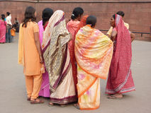 Indian women in colorful saris approach the Red Fort's main gate Stock Photography