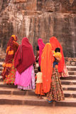 Indian women in colorful saris with kids walking up the stairs a Royalty Free Stock Photo