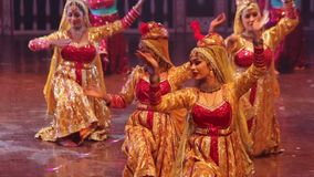 Indian women dancers are dancing the dance on stage. India. Agra