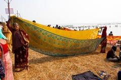 Indian women dry sari on the sun stock image