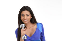 Indian women with dumb bells Royalty Free Stock Image