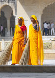 Indian Women of the fourth Caste Shudras in traditional Sari. AMER, INDIA - 19 NOVEMBER: women of fourth caste in brightly colored sari clean the Amber palace on Stock Images