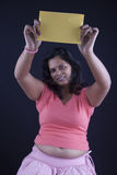 Indian women holding a yellow paper Royalty Free Stock Photography