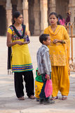 Indian women with kids standing in the courtyard of Quwwat-Ul-Is Royalty Free Stock Photography