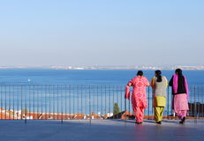 Indian women, Lisbon. LISBON - APRIL 3 2009: indian women looking at the river Tagus on April 3, 2009 in Lisbon, PORTUGAL Royalty Free Stock Image