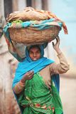 Indian women in national clothes with basket Stock Photo