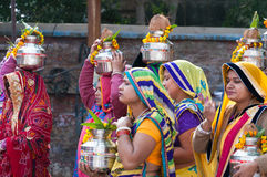 Indian women with pot on their heads in Ritual procession on the street in Vrindavan Royalty Free Stock Photo