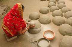 Indian women pottery maker Stock Photo