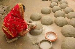 Indian women pottery maker Stock Photo
