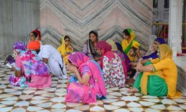Indian women praying at Golden Temple Royalty Free Stock Images