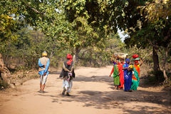 Indian women return to village Royalty Free Stock Images