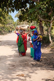 Indian women return to village Stock Photography