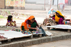 Indian women in sari and their children sells souvenirs. Kerala, India Stock Images