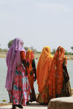 Indian women in saris walking next to a lake in Jaisalmer, India Royalty Free Stock Photo