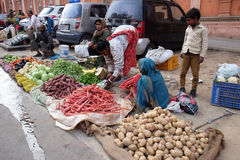 Indian women sell fruit and vegetables by the side of the road in Jaipur Stock Photography