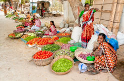 Indian women sell vegetables at street market of Puttaparthi. Royalty Free Stock Photos