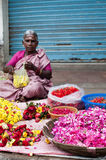 Indian women selling colorful flower garland at street market place for religion ceremony Stock Photos