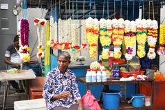 Indian women selling flower garlands at Batu Caves, Malaysia royalty free stock photography
