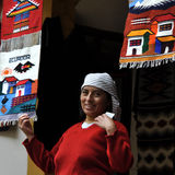 Indian women sells the products of her weaving Stock Photo