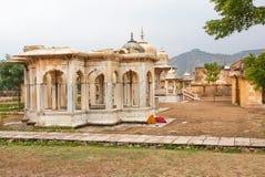 Indian women sleep near the Gaitore Cenotaphs Royalty Free Stock Photos