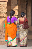 Indian women standing in courtyard of Quwwat-Ul-Islam mosque, Qu Royalty Free Stock Image