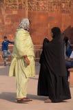Indian women standing at Qutub Minar, Delhi, India Royalty Free Stock Image