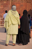 Indian women standing at Qutub Minar, Delhi, India Stock Photo