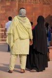 Indian women standing at Qutub Minar, Delhi, India Stock Photo