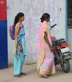 Indian women on street wearing traditional sari Royalty Free Stock Photography