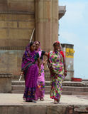Indian women on street wearing traditional sari. DELHI, INDIA - JUN 22, 2015. Indian women on street wearing traditional sari in Delhi, India. Saris are wrapped Stock Photography