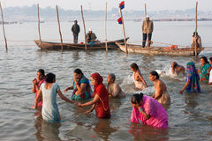 Indian women swimming in river. Indian women swim in cold water in the confluence of the river Ganges and the Yamuna during the biggest festival in the world Stock Images
