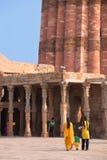 Indian women walking in courtyard of Quwwat-Ul-Islam mosque, Qut Royalty Free Stock Image