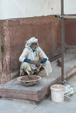 Indian worker, Agra, India. Indian worker and elderly preparing dough to fix a wall royalty free stock photos