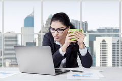 Indian worker with laptop and drinks Stock Photo
