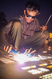 Indian worker welding Royalty Free Stock Image