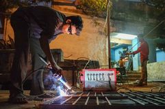 Indian worker welding Stock Photos