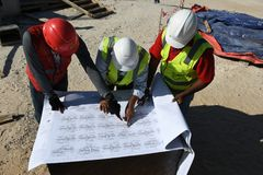 Indian workers engineers are working on the construction site royalty free stock photo