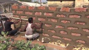 Indian workers make new brick wall in Puri, Odisha,India stock footage