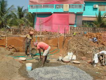Indian workers pour the Foundation of the hut. GOA. Royalty Free Stock Photography