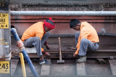 Indian workers without protective equipment, are repairing railw Stock Photography
