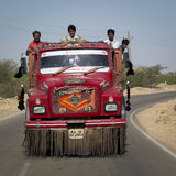 Indian workers in a red truck. Stock Photo