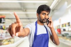 Indian working at store making do not disturb gesture stock photos