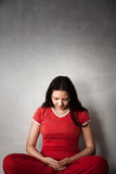 Indian Yoga Girl in red dress Royalty Free Stock Photography