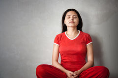 Indian Yoga Girl in red dress. A beautiful Young Indian girl in red dress doing yoga Stock Images