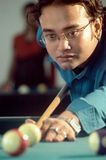 Indian Young. An Indian young man is playing Snooker in Club Royalty Free Stock Photos