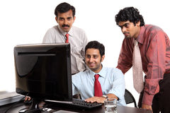 Indian young business people in office. Isolated on white Stock Photos