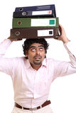 Indian young businessman with heavy works Stock Photography