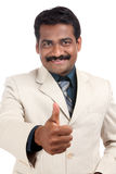 Indian young businessman showing thumbs up Royalty Free Stock Photo